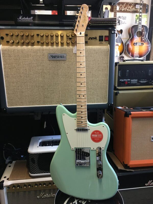 "Featuring the brand new Squier Paranormal range from Fender. It offers unique guitars at very affordable prices. Top quality and amazing playability make these guitars stand out from the crowd. This is a offset Telecaster design in Surf Green. Spec: Body: Okoume Body Finish: Gloss Polyurethane Body Shape: Jazzmaster Neck Material: Maple Neck Finish: Gloss Polyurethane Neck Shape: ""C"" Shape Scale Length: 25.5"" (648 mm) Fingerboard: Maple Fingerboard Radius: 9.5"" (241 mm) Number of Frets: 22 Frets Size: Narrow Tall String Nut: Synthetic Bone Nut Width: 1.650"" (42 mm) Position Inlays: Black Dot Truss Rods: Single Action, Head Adjust Bridge Pickup: Fender-Designed Alnico Single-Coil Neck Pickup: Fender-Designed Alnico Single-Coil Controls: Master Volume, Master Tone Pickup Switching: 3-Position Blade: Position 1. Bridge, Position 2. Bridge and Neck, Position 3. Neck Bridge: 3-Saddle Vintage-Style Strings-Through-Body Tele with Chrome Barrel Saddles Hardware Finish: Chrome Tuning Machines: Vintage-Style Pickguard: 3-Ply Parchment Control Knobs: Knurled Flat-Top"